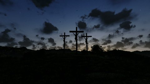 Jesus on Cross, meadow with olives, timelapse sunrise night to day - stock footage