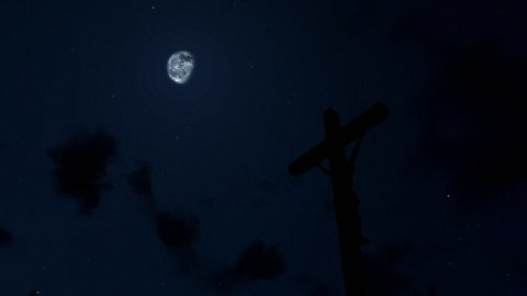 Jesus on Cross, timelapse clouds at night - editable clip, motion graphic, footage stock