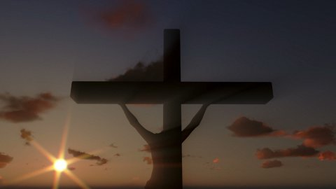 Jesus on Cross, close up, timelapse clouds at sunset - stock footage