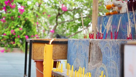 candles and smoking prayer sticks - stock footage