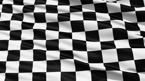 Fluttering Black And White Chequered Flag LOOP - stock footage