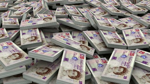 Pile of 20 pound currency stacks (loop) - stock footage