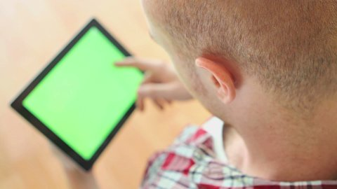 Typing on tablet computer, green screen - stock footage