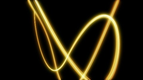 loopable background yellow light streak on black - stock footage