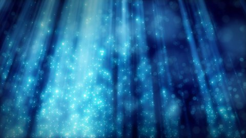 blue loopable background flying particles in light beams - stock footage