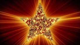 shining star shape of orange particles loopable - motion graphic