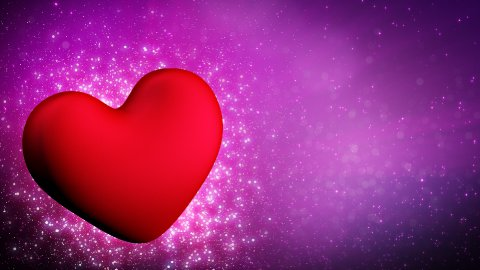 shining heart shape and particles loopable - stock footage
