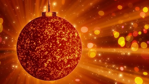 orange christmas ball close-up and lights loop - stock footage