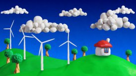 ecologic scene house and wind turbines loop clay animation - motion graphic