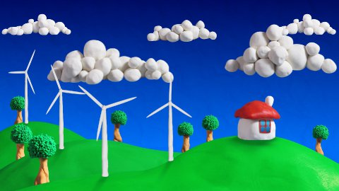 ecologic scene house and wind turbines loop clay animation - stock footage