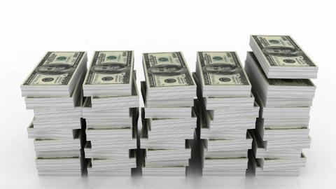 Falling stacks of 100 dollar currency - stock footage