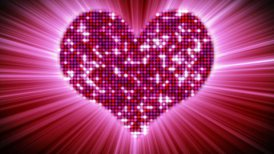 shining heart shape of pink particles loopable
