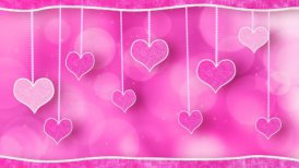 pink hearts dangling on strings love loop background - motion graphic