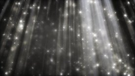black and white background glittering particles in light beams loop - motion graphic