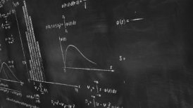 math physics formulas on chalkboard panning loop - motion graphic