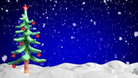 clay animation christmas tree and snowfall loopable - motion graphic