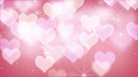pink bokeh hearts and particles loop