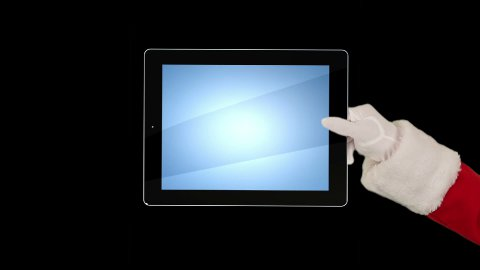 Santa Claus Presenting a Tablet then sending a Kiss and saying Bye Bye, against black