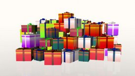Magically piling up gift boxes, against white