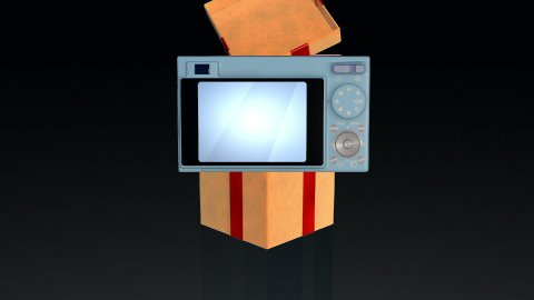 Gift box opening lid to present a digital camera, against black  - stock footage