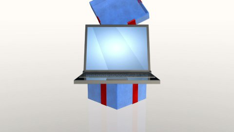 Gift box opening lid to present a laptop, against white