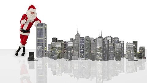 Santa Claus magically building a modern city, against white