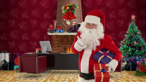 Santa Claus holding presents in his modern Christmas Office - stock footage