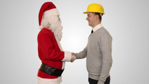 Santa Claus and Young Architect against white, shaking hands and looking at camera - stock footage