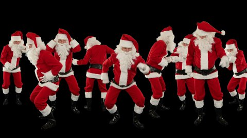 Bunch of Santa Claus Dancing Against Black, Christmas Holiday Background - stock footage