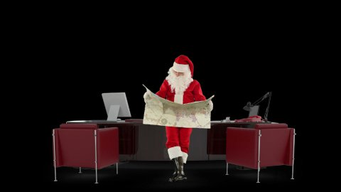 Santa Claus reading a map in his modern Christmas Office, against black - stock footage