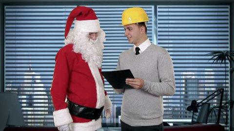 Santa Claus and Young Architect in a modern office - stock footage