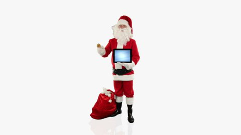 Santa Claus presenting a blank tablet, against white - stock footage