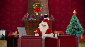 Santa Claus reading letters, office with Christmas decorations
