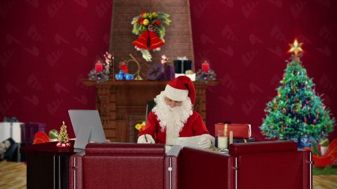 Santa Claus reading letters, office with Christmas decorations - stock footage