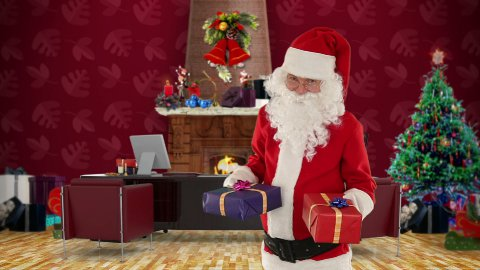 Santa Claus weighting presents in his modern Christmas Office - stock footage