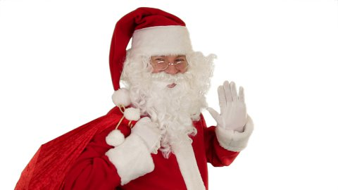 Santa Claus carrying his bag, looks at the camera sends a kiss and wave - stock footage