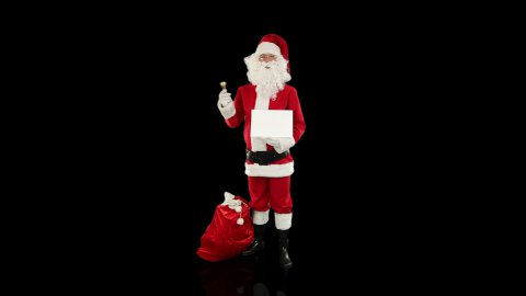 Santa Claus presenting a white sheet, against black - stock footage