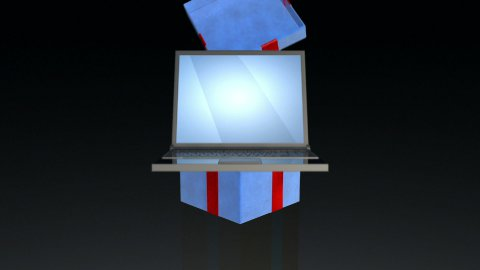 Gift box opening lid to present a laptop, against black - stock footage