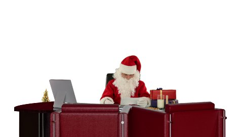 Santa Claus reading letters and sorting presents, against white - stock footage
