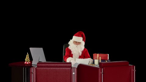 Santa Claus reading letters, against black - stock footage