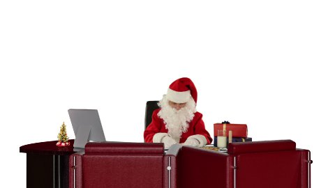 Santa Claus at work, against white - stock footage