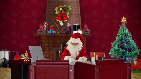 Santa Claus at work, office with Christmas decorations - stock footage