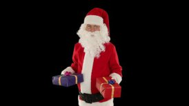 Santa Claus weighting presents, against black  - motion graphic