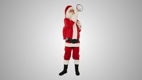 Santa Claus with a loudspeaker making an announcement, front view, against white - stock footage