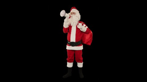 Santa Claus with a loudspeaker making an announcement, against black - stock footage