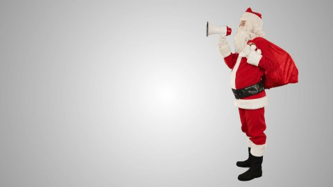 Santa Claus with a loudspeaker making an announcement, side view, against white - stock footage