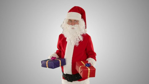 Santa Claus weighting presents, against white - stock footage