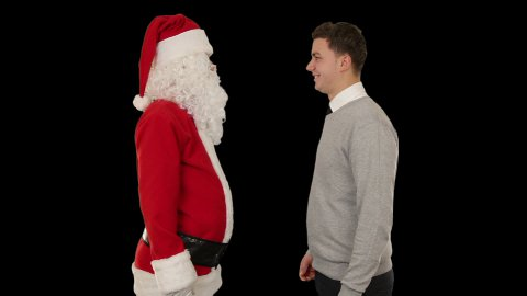 Santa Claus and Young Businessman against black, shaking hands and looking at camera - stock footage