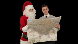 Santa Claus with a Young Businessman reading a map, against white