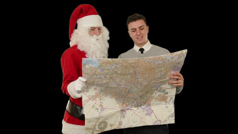 Santa Claus with a Young Businessman reading a map, against white - stock footage